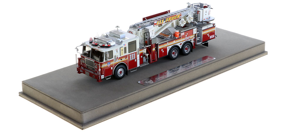 FDNY Tower Ladder 111 includes a fully custom display case.
